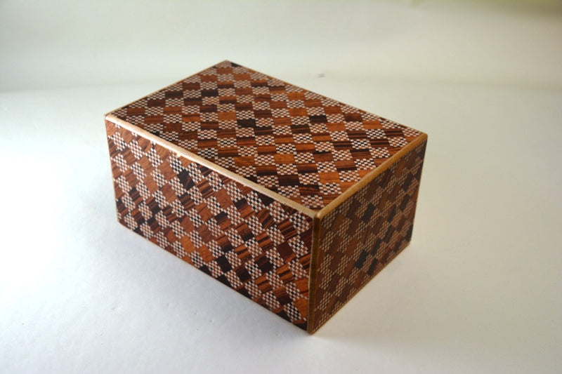 products/6_Sun_10_Step_Red_Ichimatsu_Japanese_Puzzle_Box_with_Secret_Drawer_2.jpg