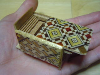 products/mame-22-oka-japanese-puzzle-box-in-hand.jpg