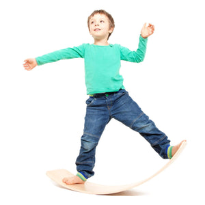 Wooden Balance Board with Bounce - child playing