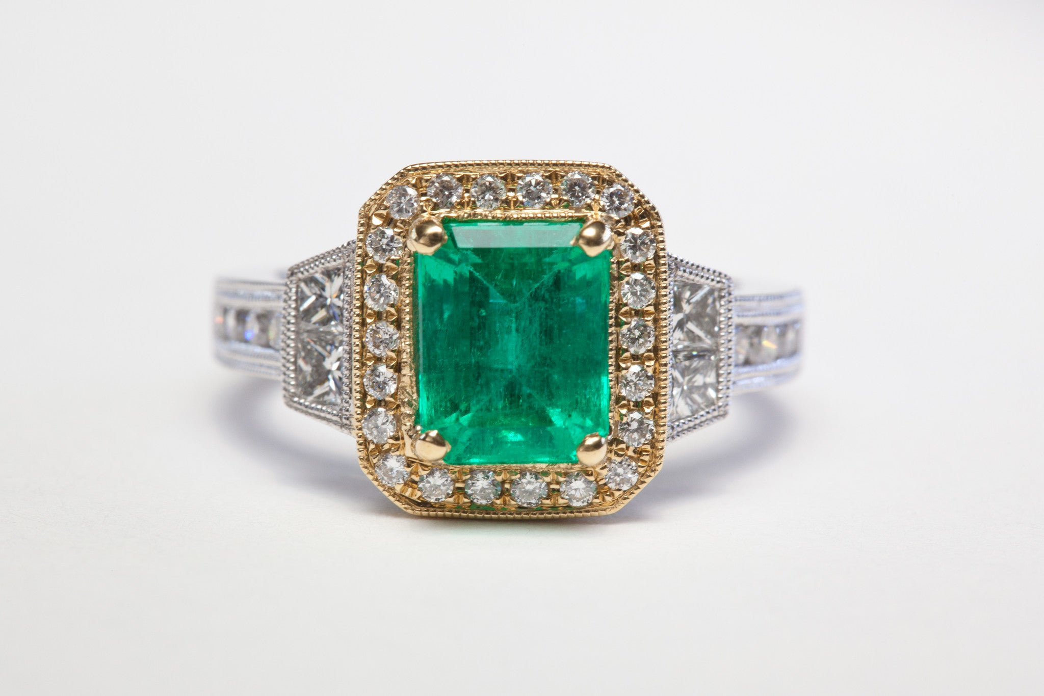 2 Carat Emerald ring with diamond accents in Platinum and 18 Karat