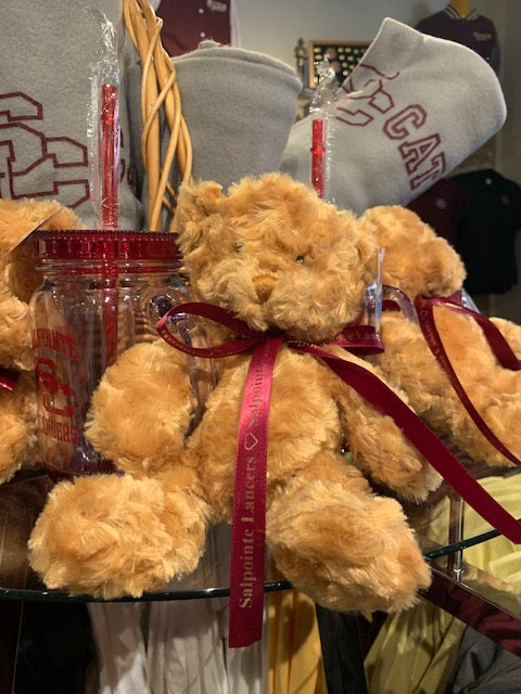 plush teddy bear with ribbon