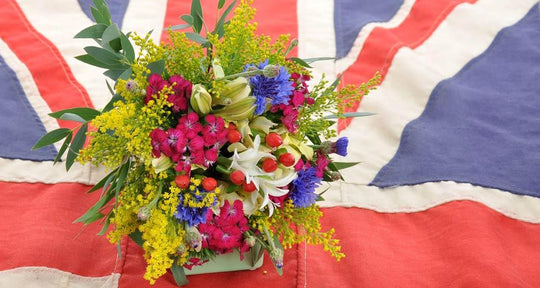 Flowers on Union Jack flag.
