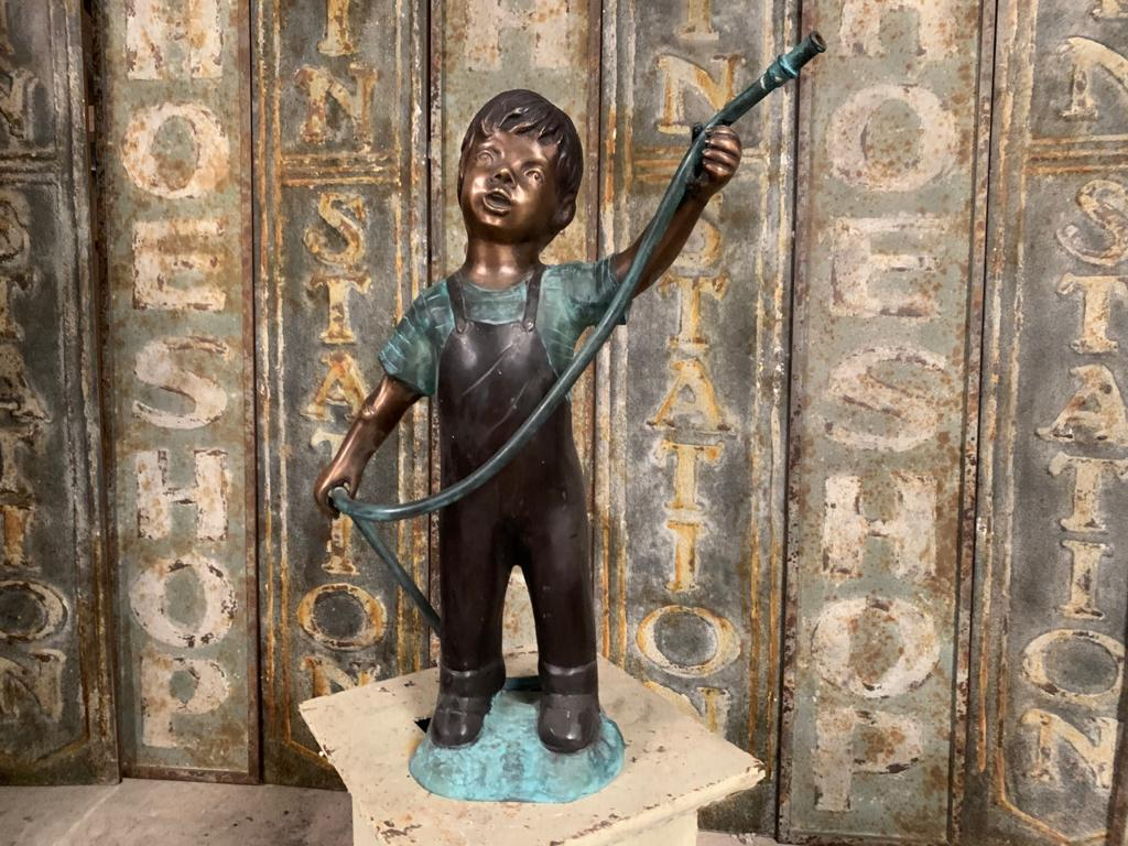 Cast Bronze Figure of a Boy Holding a Hose Pipe