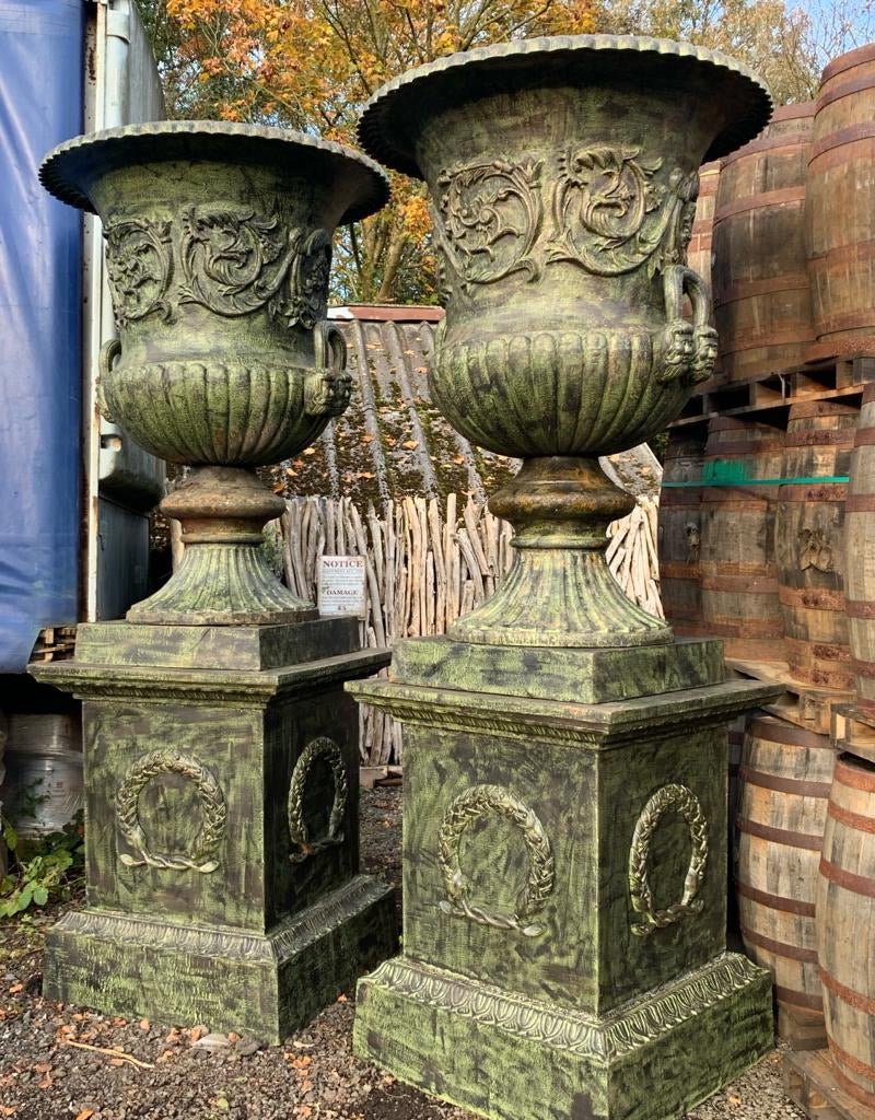 Pair of Massive Cast Iron Urns