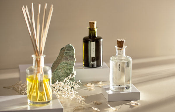 Aery Living Botanical Collection Reed Diffuser with decorative props and plints on a cream background