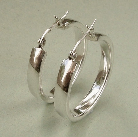 Smooth, sterling silver 1 inch hoop earrings.