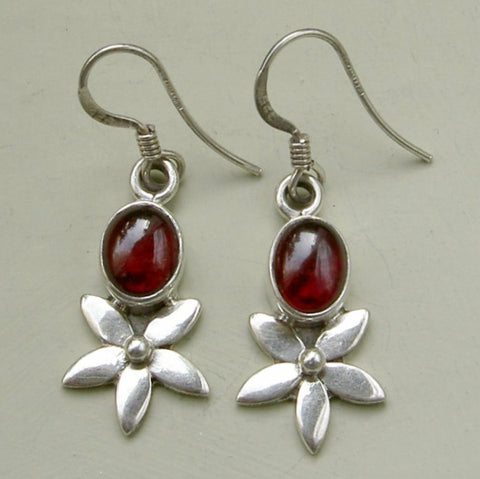 Sterling silver flower earrings with garnet cabochon.