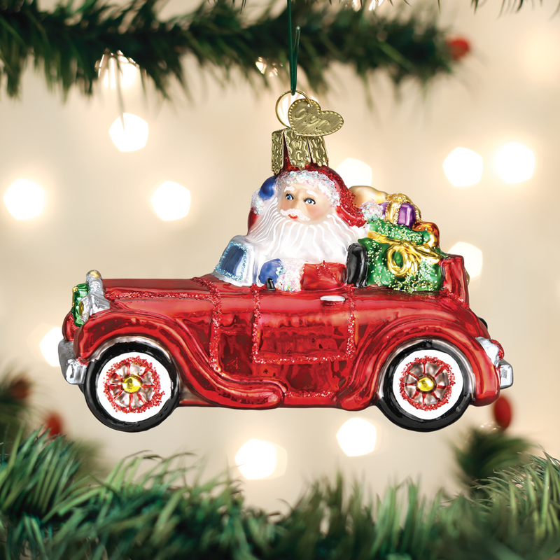 Old Word Christmas Santa in Antique Car Glass Ornament