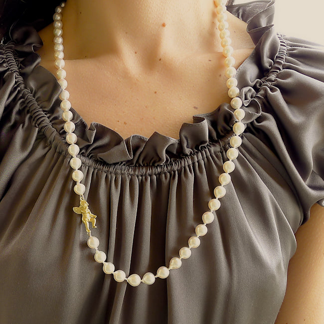 Baroque Pearl Strand with Cherub