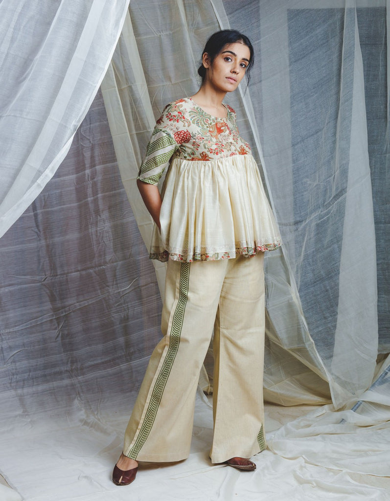 Organic linen ecru pants with kadi side border