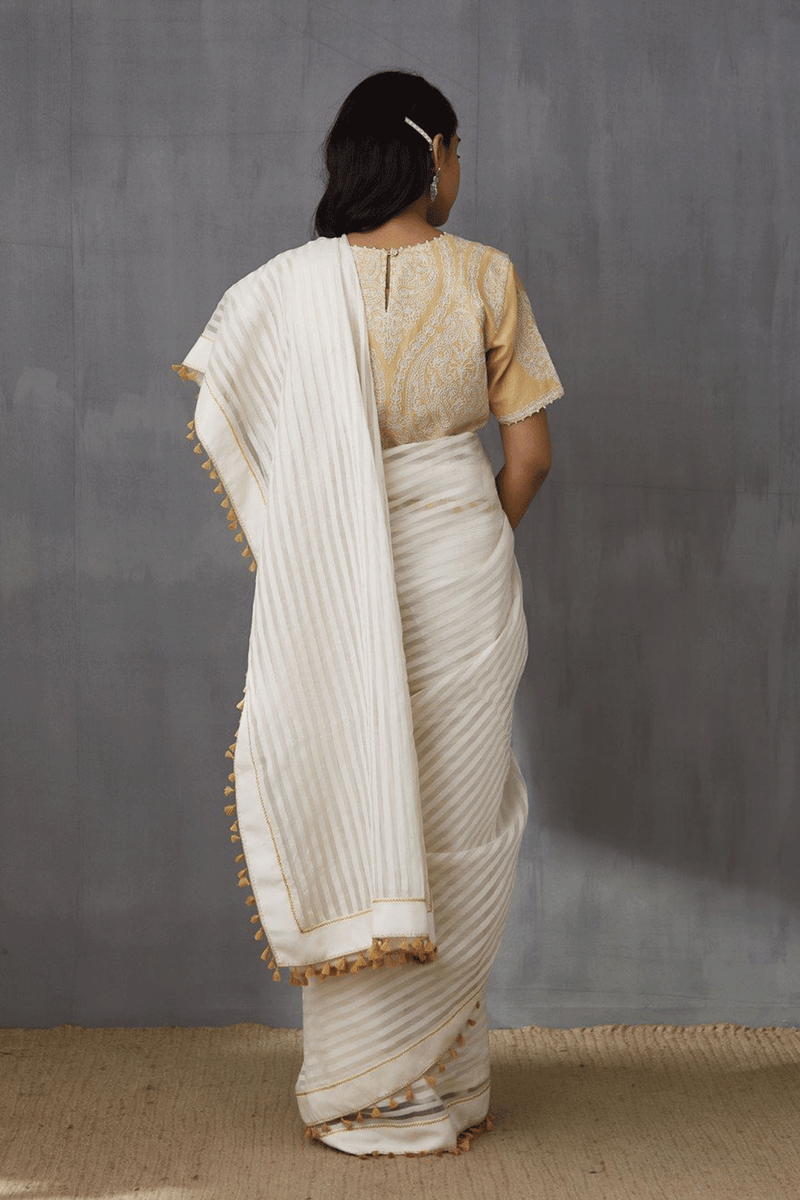 Ecru handloom chanderi saree with all over yellow tassels
