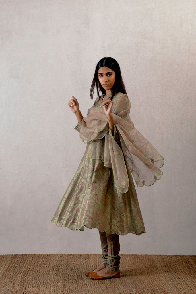 Pista Jhoolan block printed chanderi kurta with scallop embroidery paired with a churidar and cutwork odhani