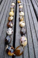 (SPL00062) Petrified Peanut Wood from Australia oval beads