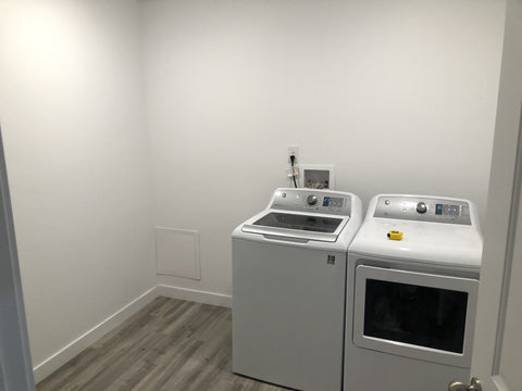 luxury modern laundry room makeover with stick on stone tiles on a budget