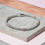 DIAMOND CUT SILVER BRACELET WITH ROSE GOLD BANDS