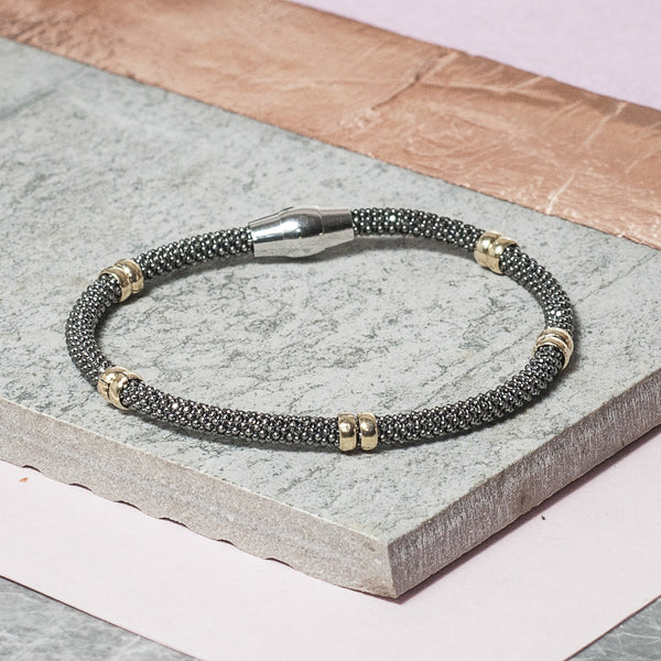 DIAMOND CUT BLACK BRACELET WITH GOLD BANDS
