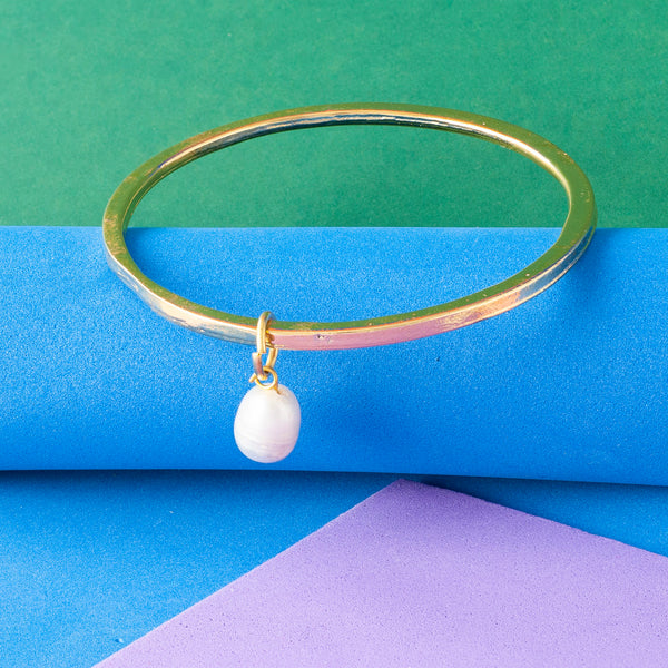 GOLD BANGLE WITH PEARL CHARM