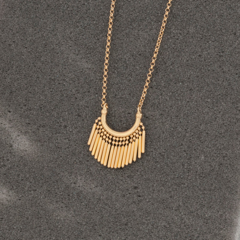GOLD TASSEL CHARM NECKLACE