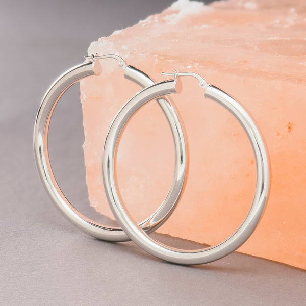 THICK SILVER MEGA HOOP EARRINGS