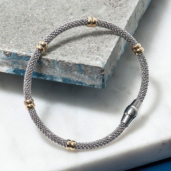 DIAMOND CUT SILVER BRACELET WITH GOLD BANDS