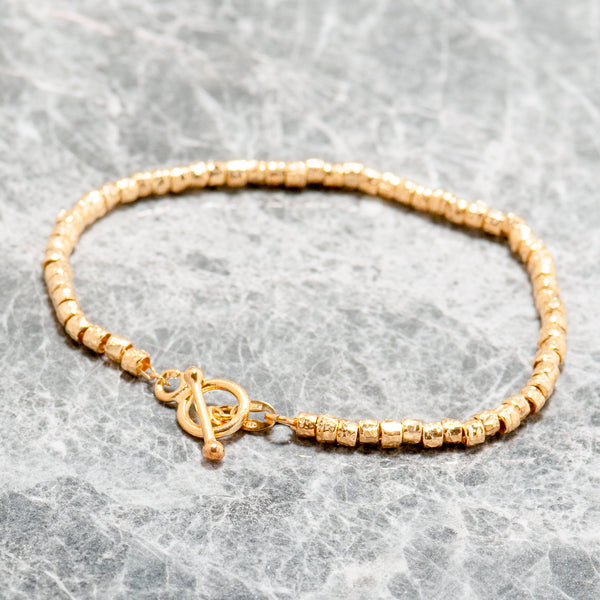 GOLD TEXTURED BEAD BRACELET