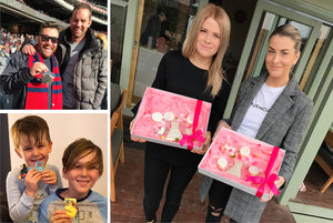 Friends and family holding cookie boxes