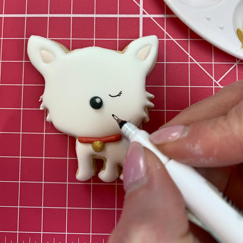 Adding eyes to the white dog cookie