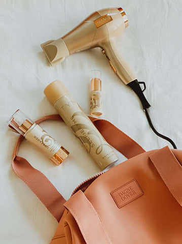 BlowTYME Hair Dryer with SelfieTYME Hairspray, Upstaged Thermal Protectant, and BigTYME Root Lift Powder in handbag