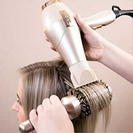 Drying straight hair with BlowTYME and 3-inch round brush.
