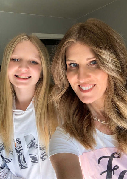 Blonde mother and daughter smiling for a selfie