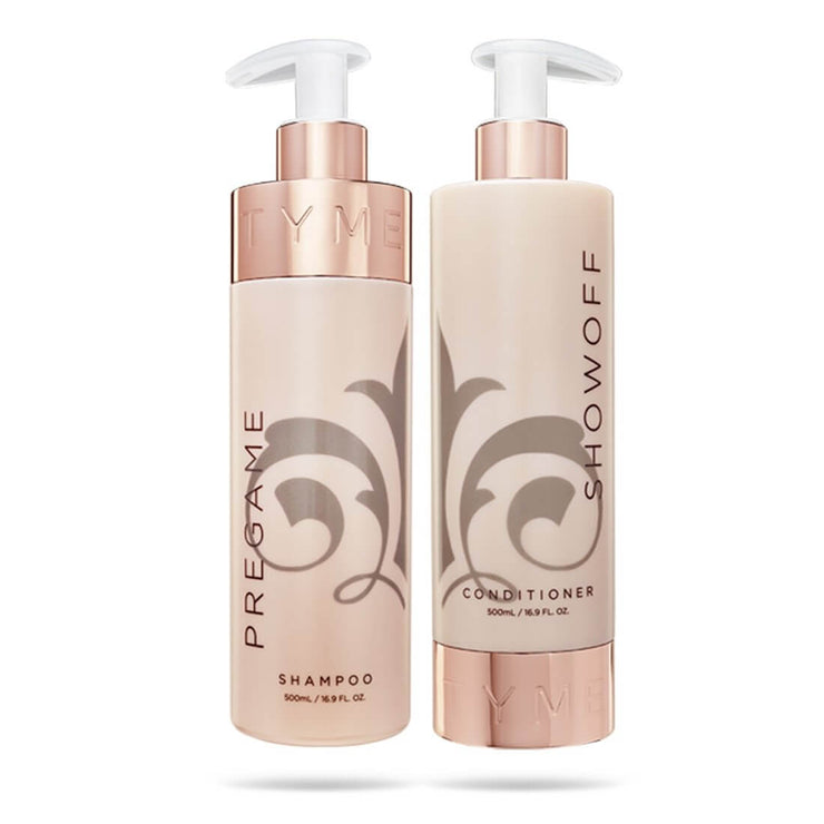 TYME shampoo and conditioner bottles together showing fleur de lis.