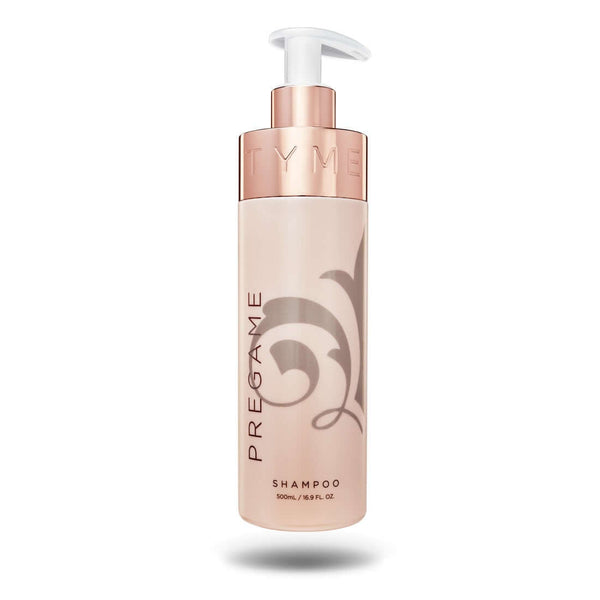 TYME PREGAME Shampoo in beige 16.9 ounce beige bottle with taupe fleur de lis logo and rose gold pump nozzle.