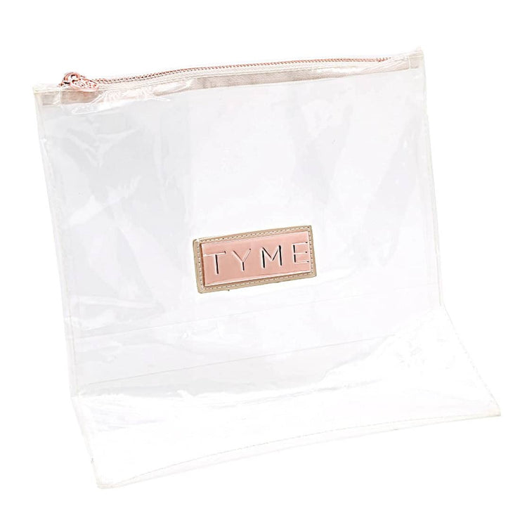 TYME zippered, clear travel bag with TYME name in rose gold.
