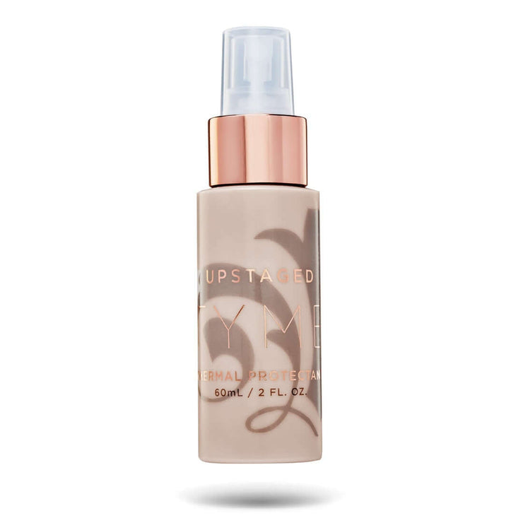 Travel size 2 ounce TYME Upstaged Thermal Protectant in a beige bottle with rose gold details.