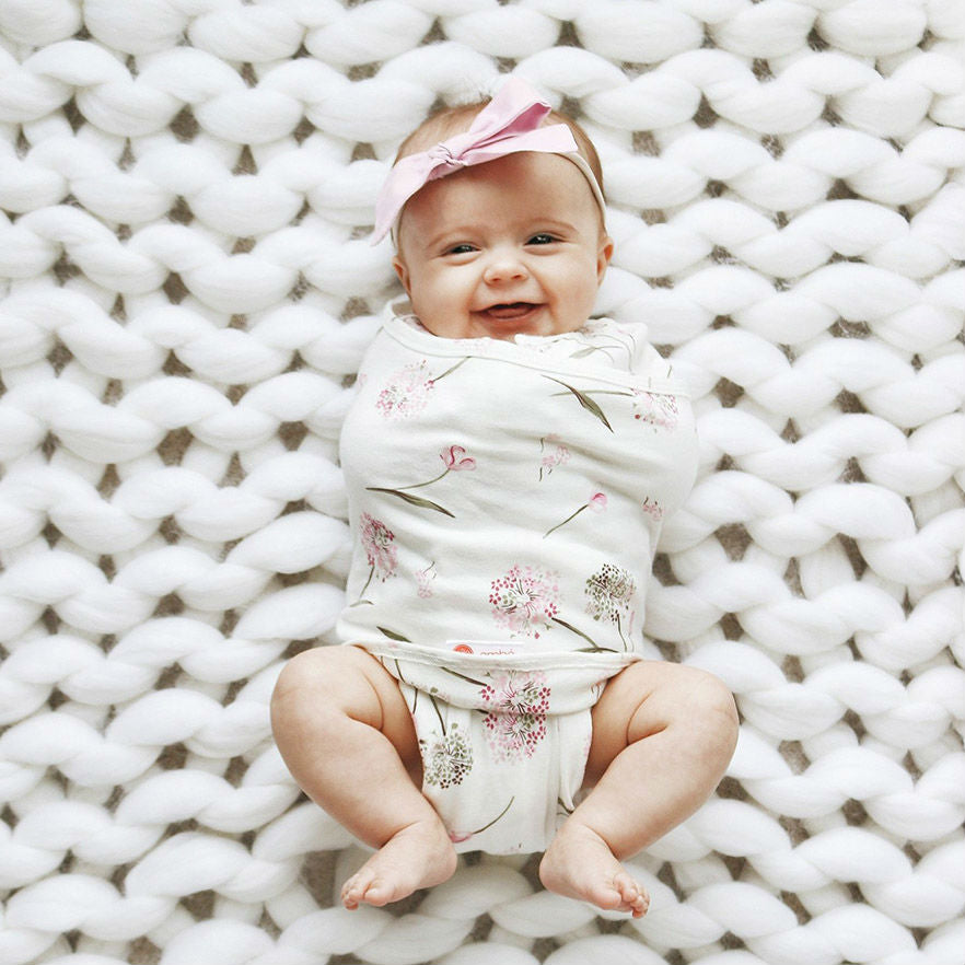 laughing baby in organic swaddle blanket