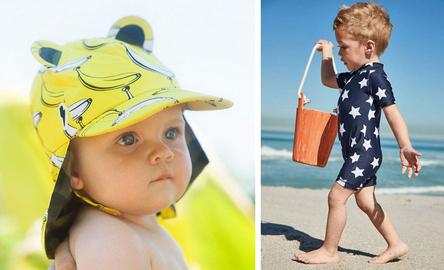 Baby in sun hat and sun protection suit