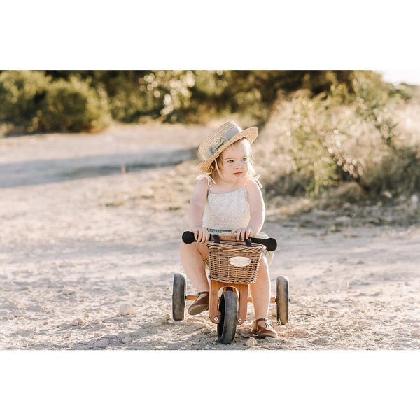Young girl riding the Kinderfeet Bamboo Trike - Tiny Tot Plus on the beach | Eco Wooden Toys - The Vegan Town