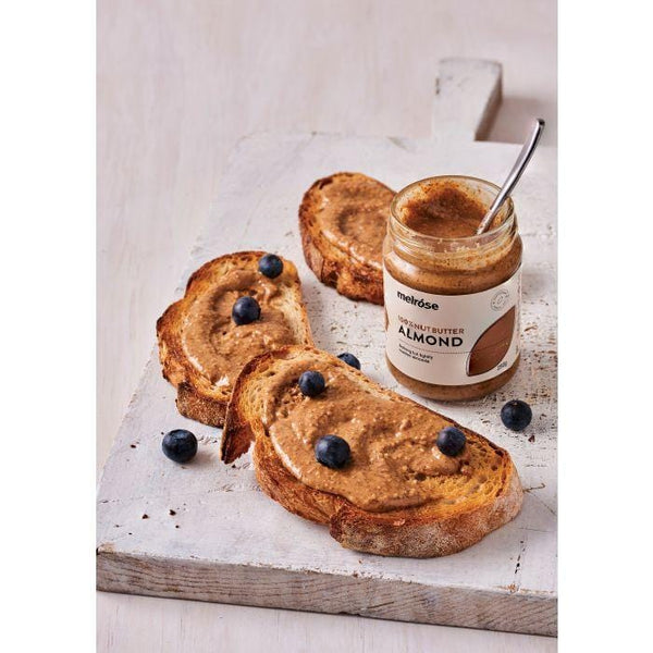 Melrose 100% Nut Butter Almond 250g vegan spread on toast with blueberries. A great vegan snack | The Vegan Town