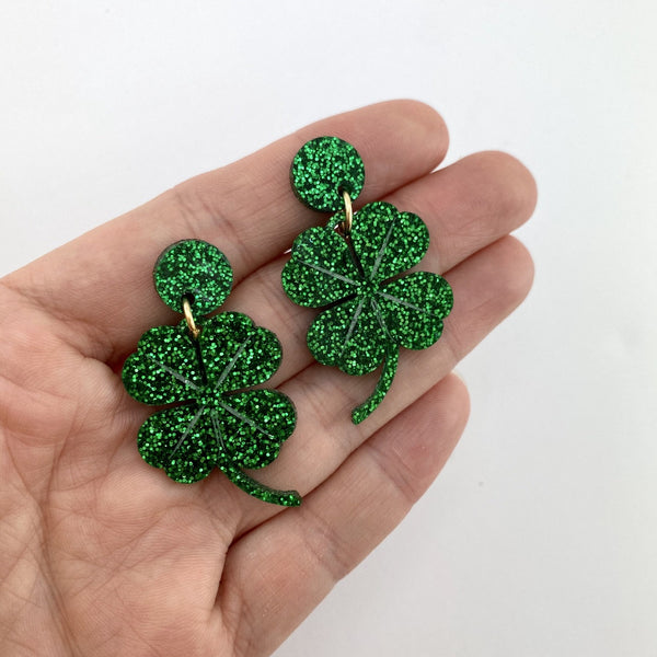 Four Leaf Clover drop earrings - dark green glitter
