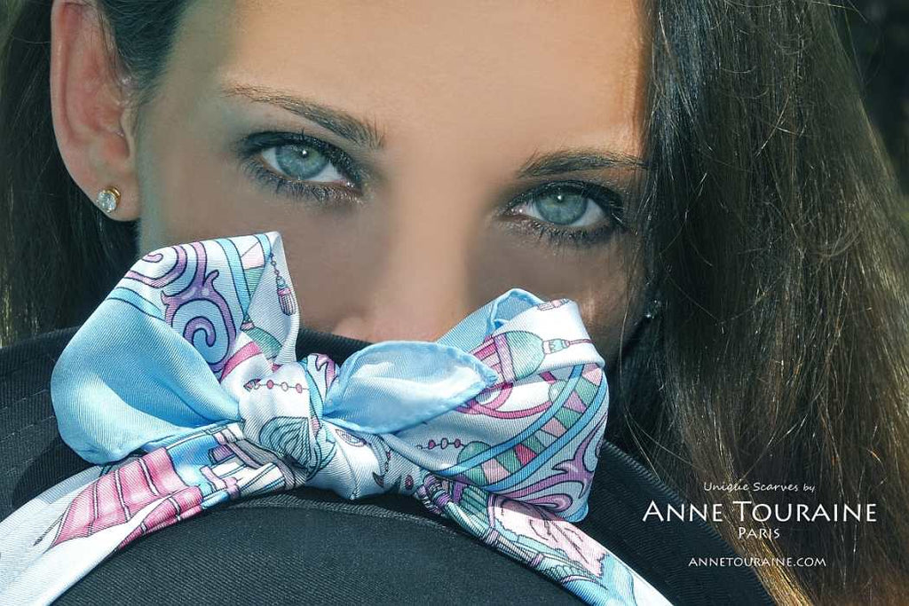 French silk scarves by ANNE TOURAINE Paris™: China inspired neon blue scarf tied  with a fluffy bow around a hat