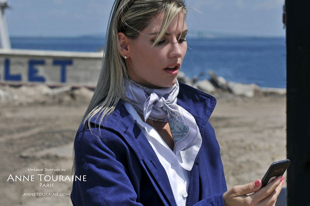 French silk scarves by ANNE TOURAINE Paris™: Paris inspired lavender blue scarf wrapped twice around the neck and tied with a double knot