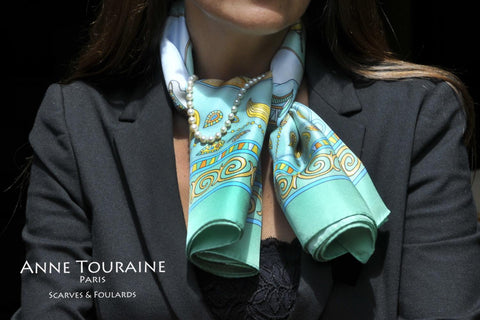 French silk scarf, neon green by ANNE TOURAINE Paris™ tied around the neck with a pearl necklace