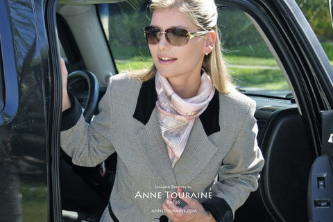 French silk scarf, Paris theme, pink color, by ANNE TOURAINE Paris™ tied around the neck in a fluffy kerchief
