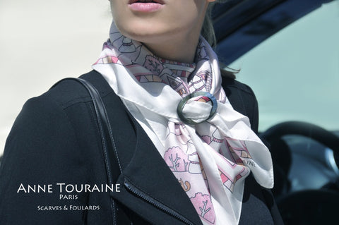 French silk scarf, winter theme, pink color, by ANNE TOURAINE Paris™ tied around the neck and secured with a scarf ring