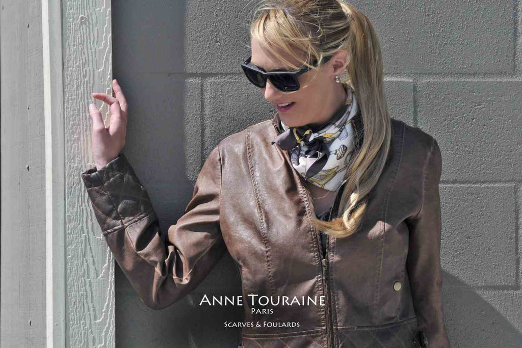 French silk scarves by ANNE TOURAINE Paris™: Brown and white Fashion Accessories scarf tied as a kerchief over a leather jacket