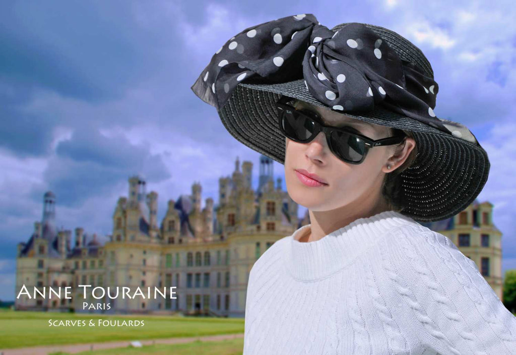 Chiffon silk scarves by ANNE TOURAINE Paris™: black polka dot scarf tied with a front fluffy bow around a straw hat