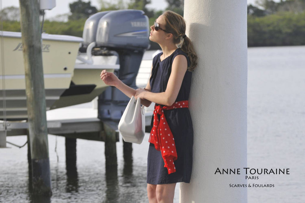 Chiffon silk scarves by ANNE TOURAINE Paris™: red polka dot scarf tied as along belt