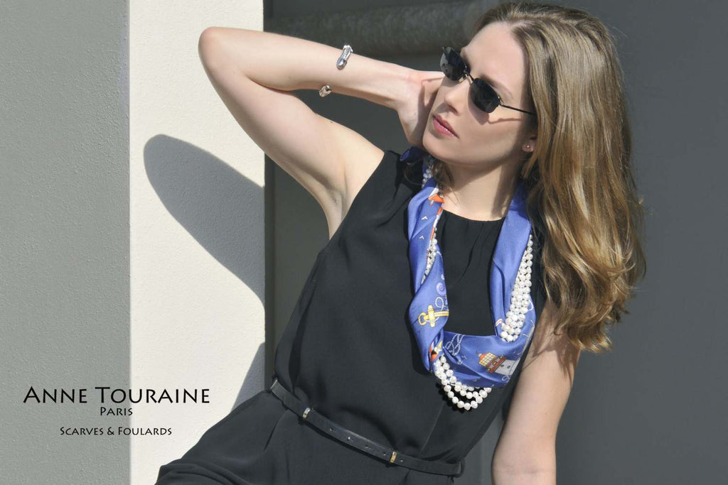 French silk scarves by ANNE TOURAINE Paris™: Nautical blue scarf intertwined with a long pearl necklace