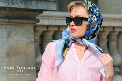 Astrology zodiac inspired silk scarf by ANNE TOURAINE Paris™; blue color; tied as a Kelly headwrap