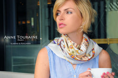 Astrology inspired silk scarf, white color tied loose around the neck: a unique creation by ANNE TOURAINE Paris™